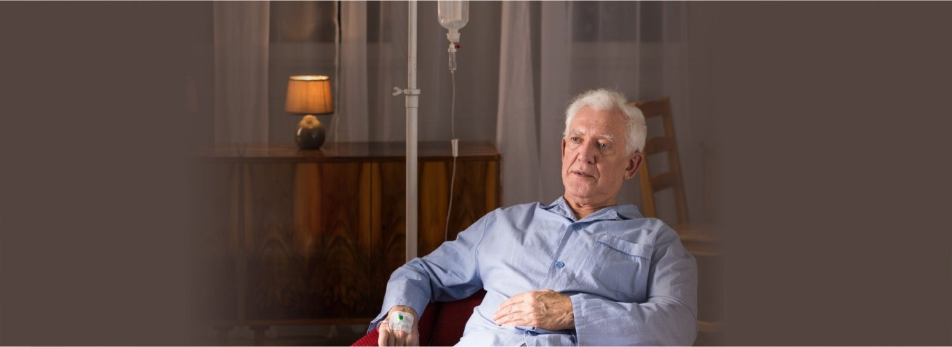 Senior patient with terminal illness sitting in an armchair