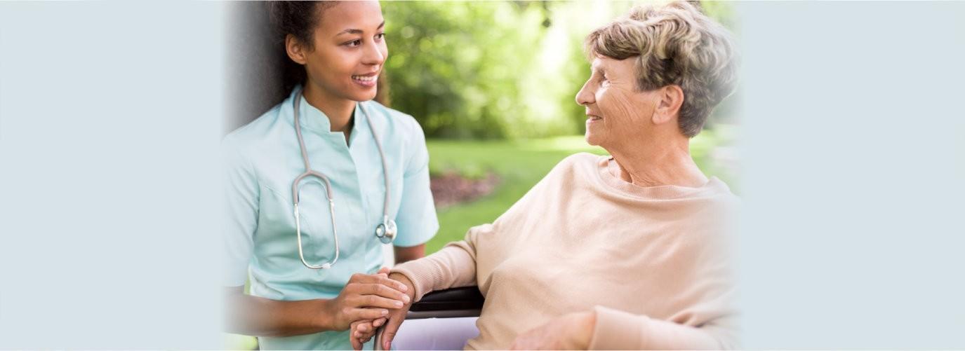 Senior women and doctor spending time in the garden