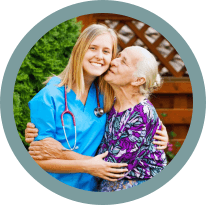senior woman kissing caregiver